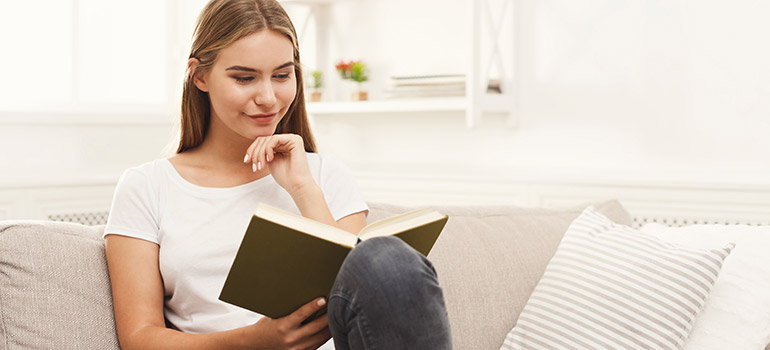 Img of woman reading book
