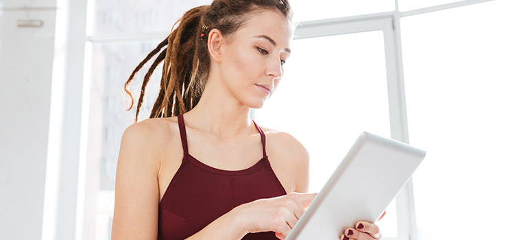 Online Trainer woman on tablet